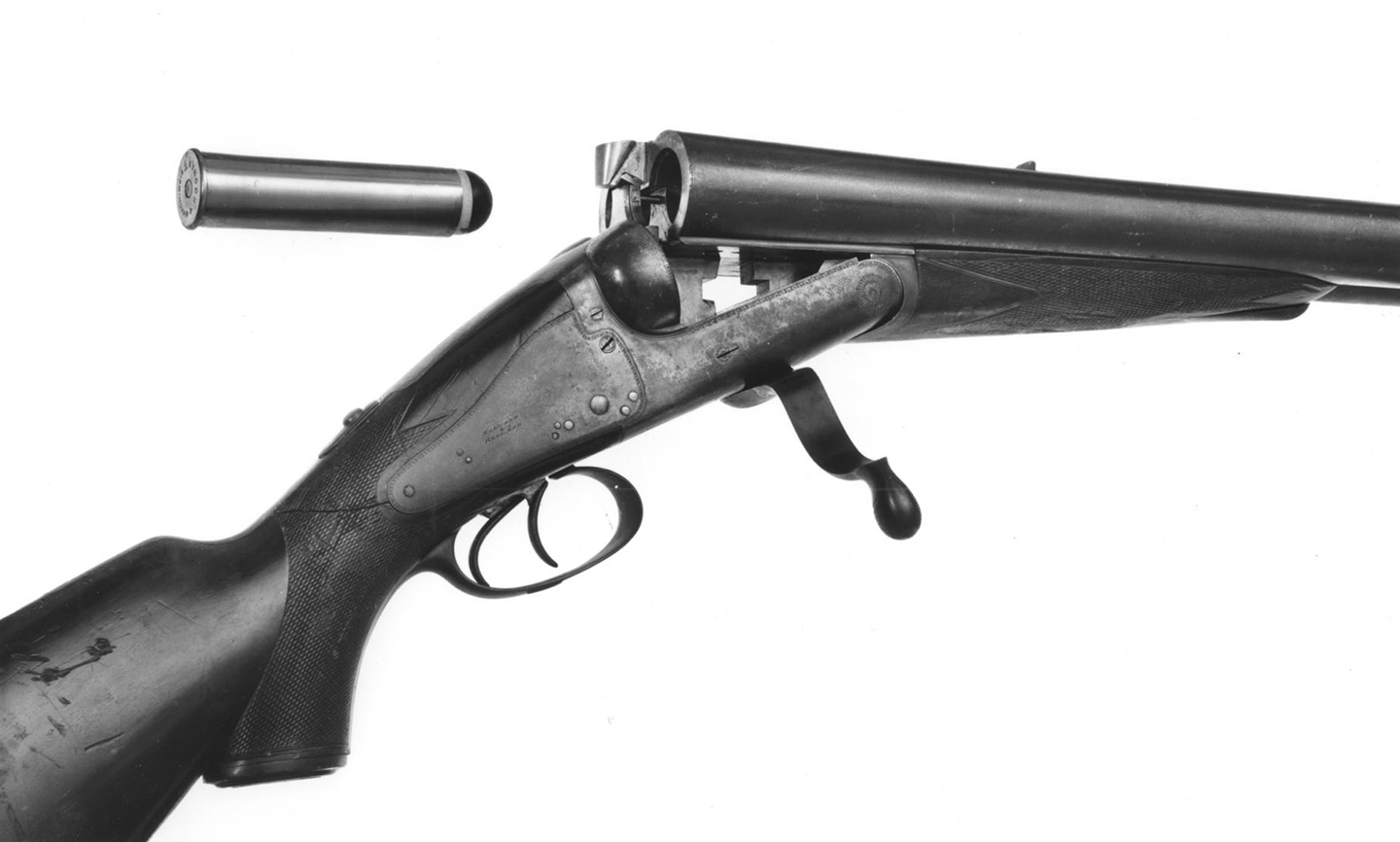 Open rifle showing both barrels and cartridge