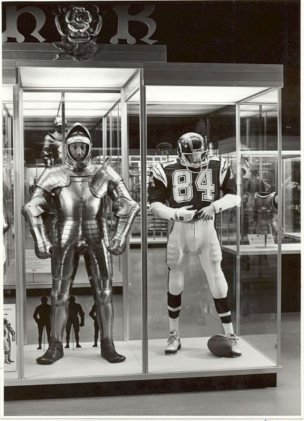 Armour of Henry VIII displayed beside an American football armour