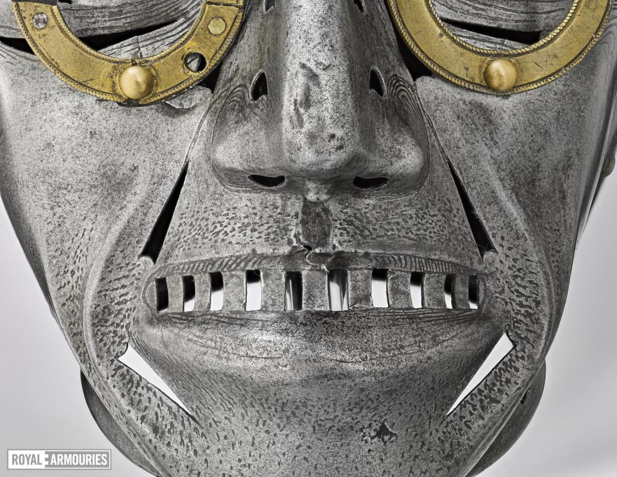 close up of the mouth of the mask, with silver etched stubble and lips shown