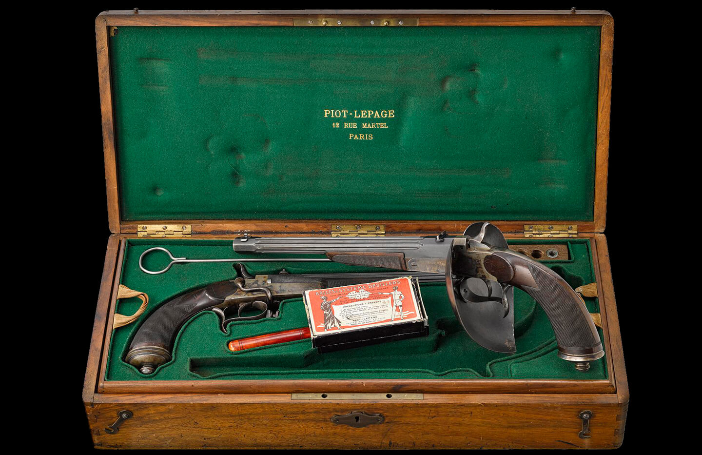 a case with two duelling pistols and accessories inside