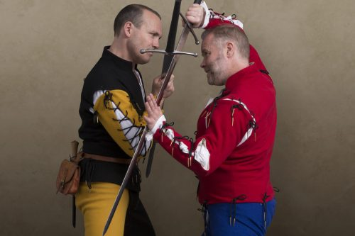 Two men fight with longswords