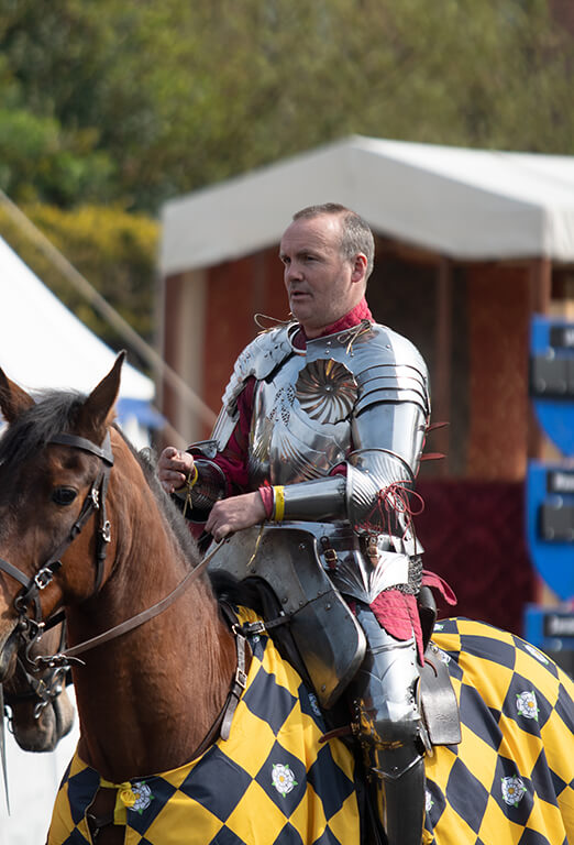 Andy Deane in armour on horseback