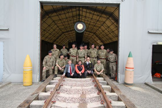 Soldiers and Royal Armouries team pose with Railway howitzer gun on display