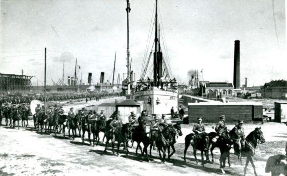 WWI troops on horseback arriving at the dockside