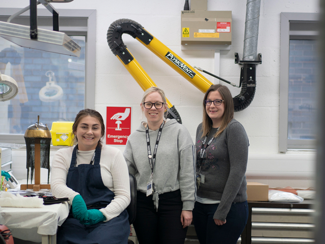 group photo of women in a conservation lab
