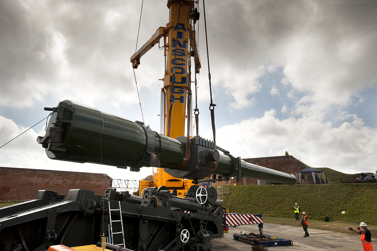 Large gun being lifted by crane