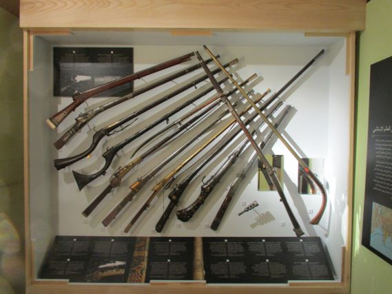 Firearms in a museum display case