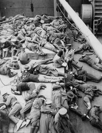 soldiers lying down on board a ship