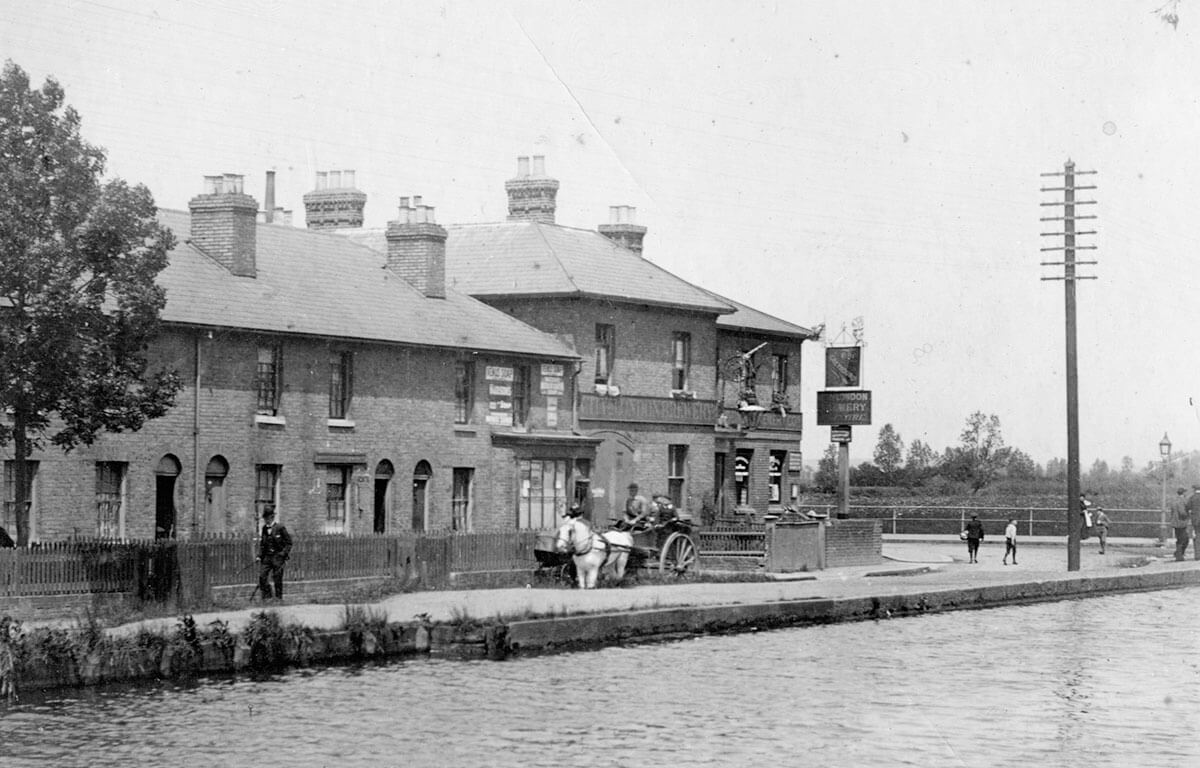pub on a canal with a horse and cart in front