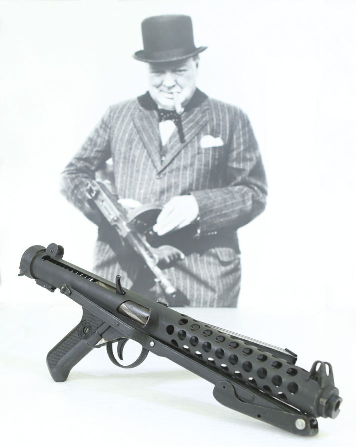 Winston Churchill famous photograph of him holding a tommy gun, with a sterling smg in front of the photo