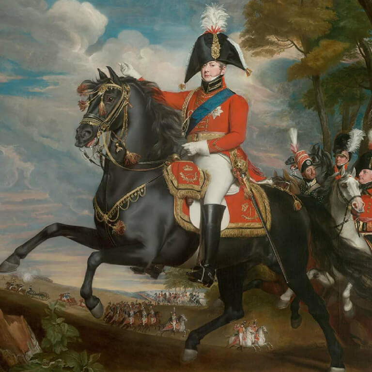 A man in horse in a red British officer uniform points to the distance while troops maneuver in the background