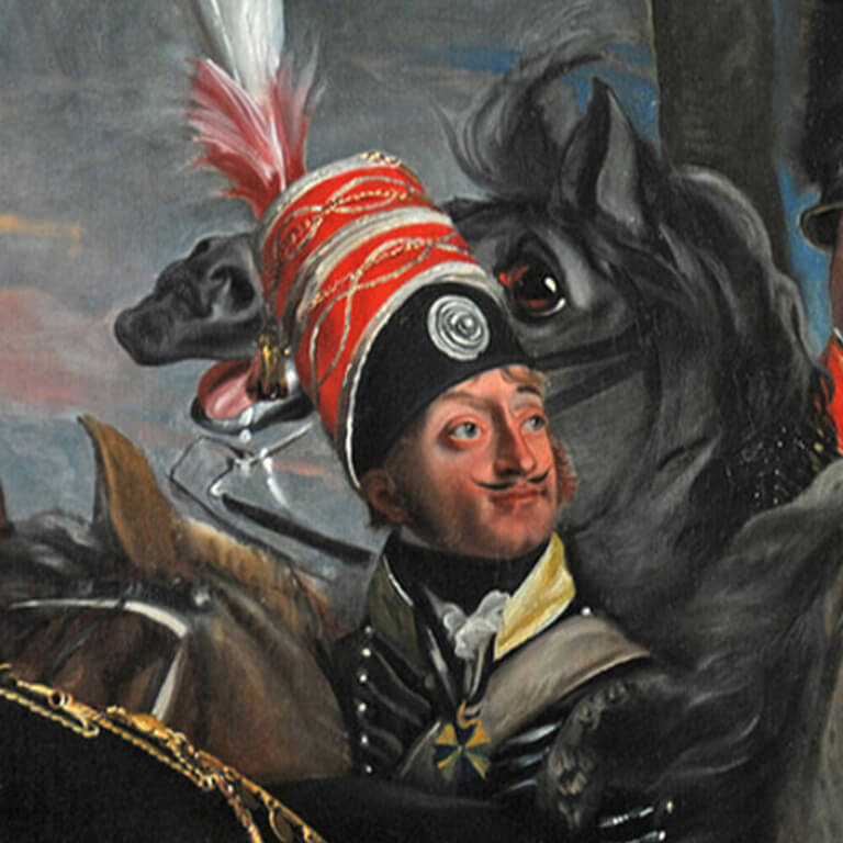 A man with a mustache and sideburns is wearing a ornate blue and red hat while a horse looks energetic in the background.