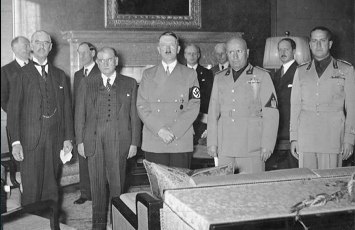 Nazi Leadership stands in a row with Neville Chamberlain after signing the Munich agreement.