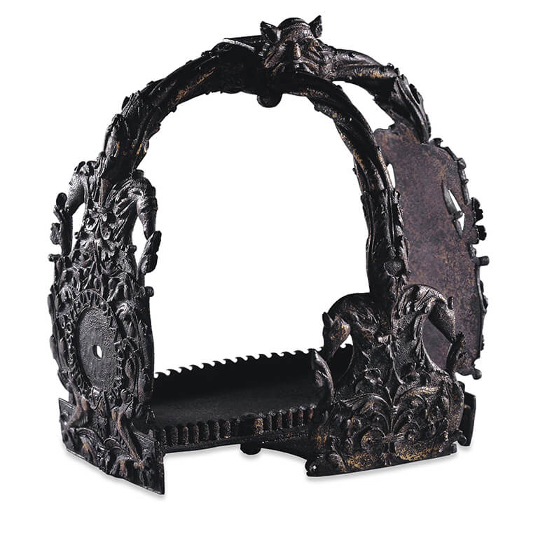 An ornate horse stirrup