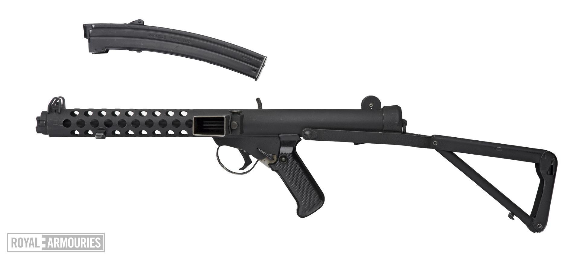 Sterling machine gun and magazine