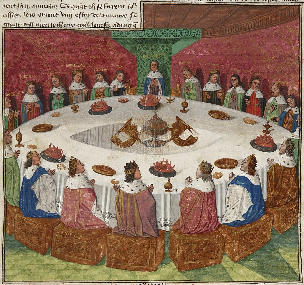 Image of the Round Table with knights seated all the way around.