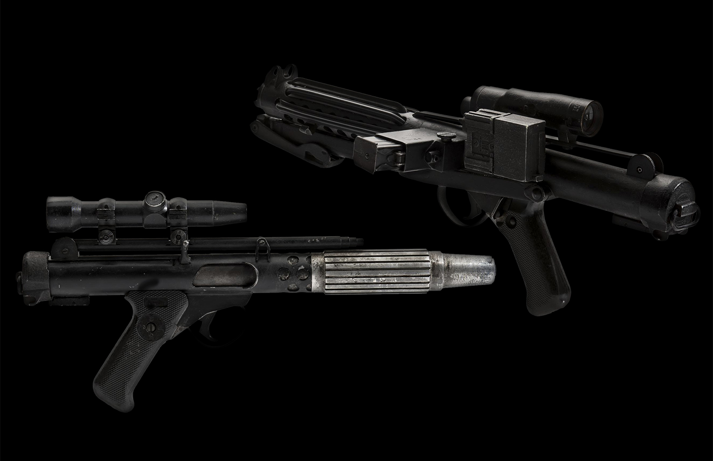 two blasters from the Star Wars movies