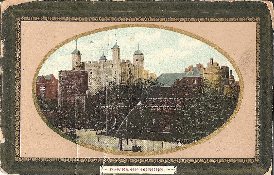 A framed postcard with the title Tower of London, showingthe white tower behind the tower wall with trees in front of it in colour. All in an oval frame.
