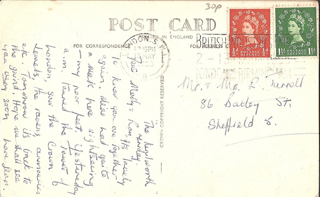 a poastcard with handwritten text and two stamps