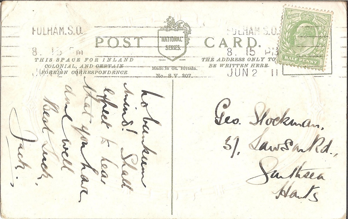 Hand written text on a postcard with a green stamp