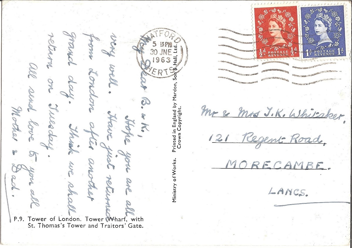 A handwritten postcard with a red and a blue stamp