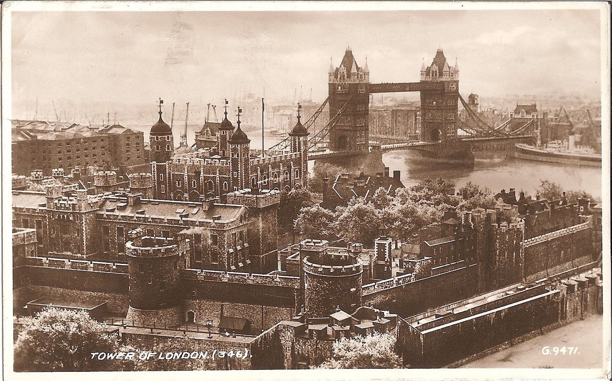 Tower of London marked postcard showing the tower ground and tower bridge in the background