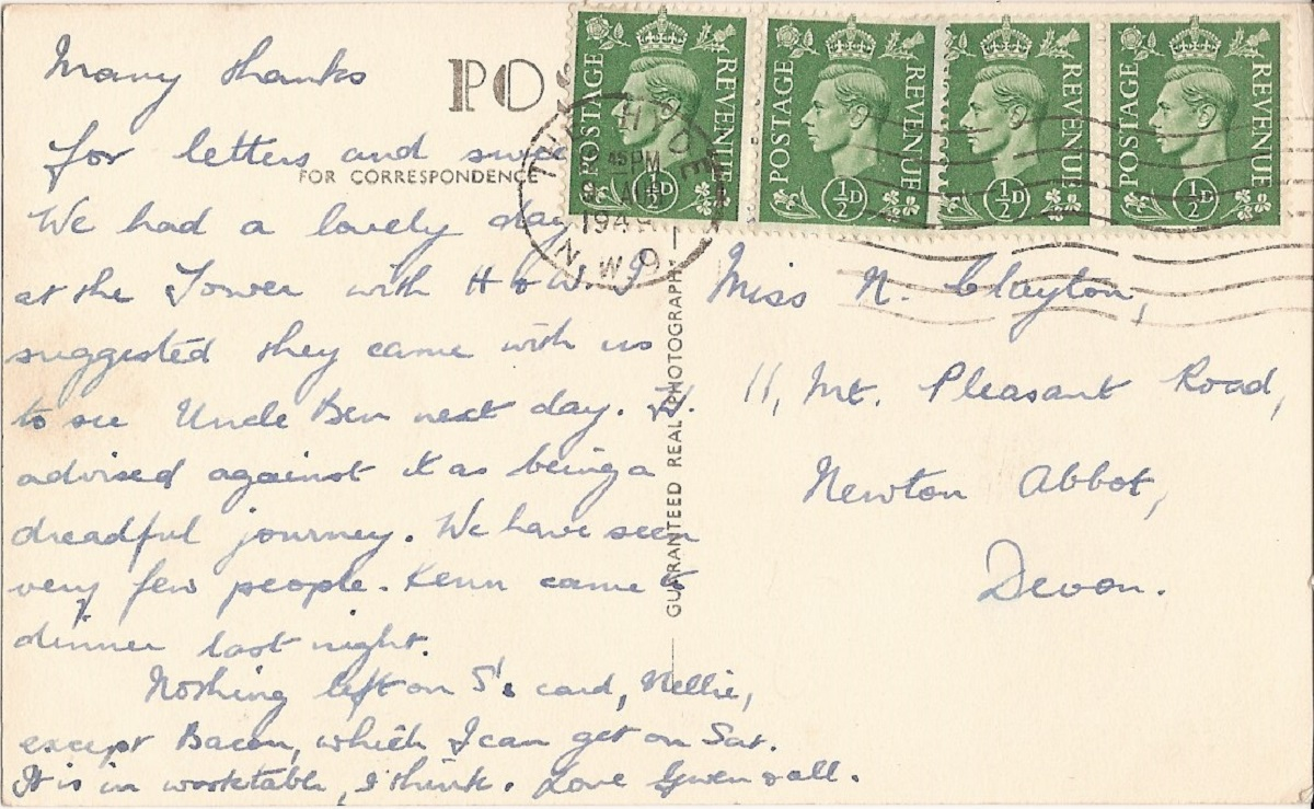 A hand written postcardw ith four green stamps