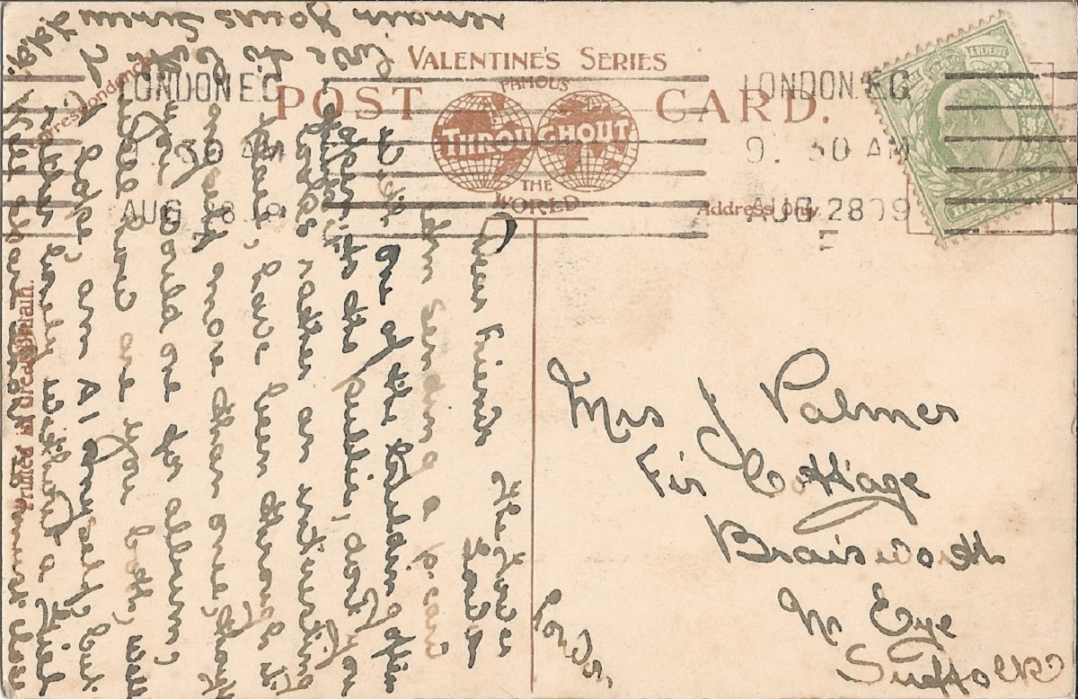 A hand written postcard with a green stamp
